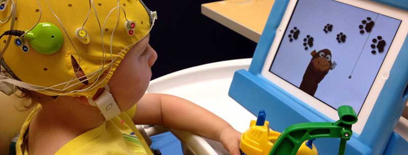child looking at a computer during a brain study